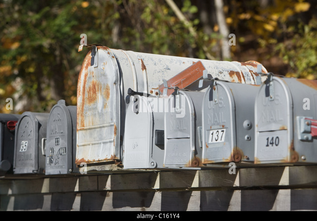 Mail boxes in a row - Stock Image