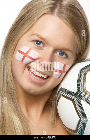 Young Female Football Fan With St Georges Flag Painted On Face - Stock Image