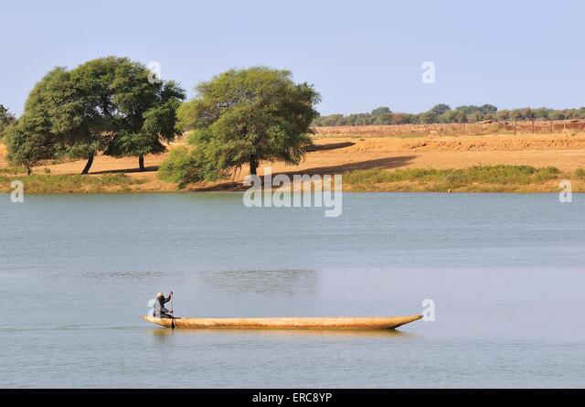 Dugout canoe on the river Senegal in Bogue, Brakna region, Mauritania - Stock Image
