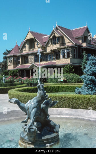 Believed to be haunted by ghosts, the Winchester Mystery House is a sprawling Victorian mansion that attracts tourists - Stock Image