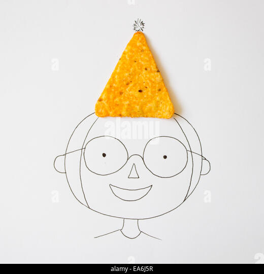 Conceptual boy wearing a party hat - Stock Image
