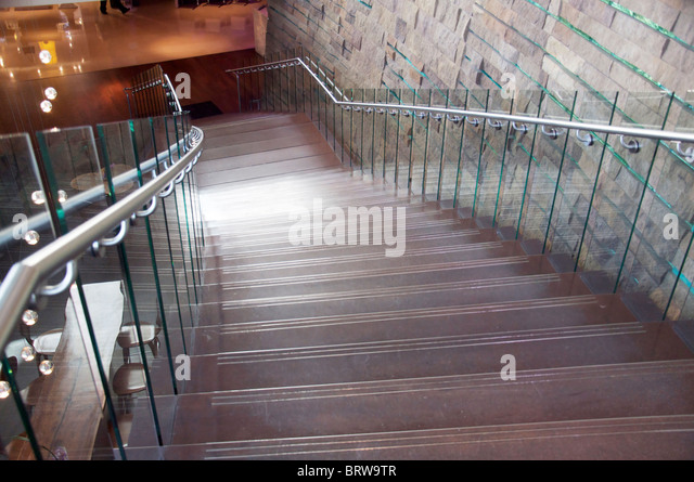 Photo of contemporary architecture featuring stylish modern designer stairs and  wall. - Stock Image