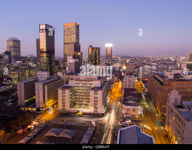 Johannesburg cityscape by night as seen from the roof of one of the buildings in the business district. - Stock Image