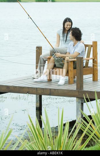 Couple fishing on pier - Stock Image