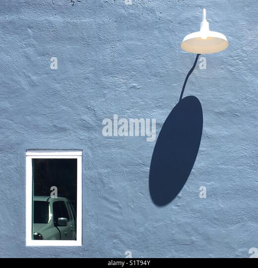 Blue Shadow Wall - Stock Image