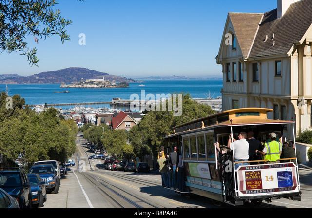 Traditional Cable Car on Hyde Street looking towards Alcatraz and Fisherman's Wharf, San Francisco, California, - Stock Image