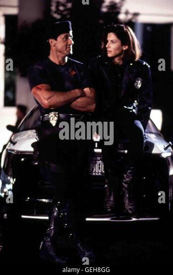 Sylvester Stallone, Sandra Bullock   Polizistin Lenia Huxley (Sandra Bullock) hilft John (Sylvester Stallone). *** - Stock Image