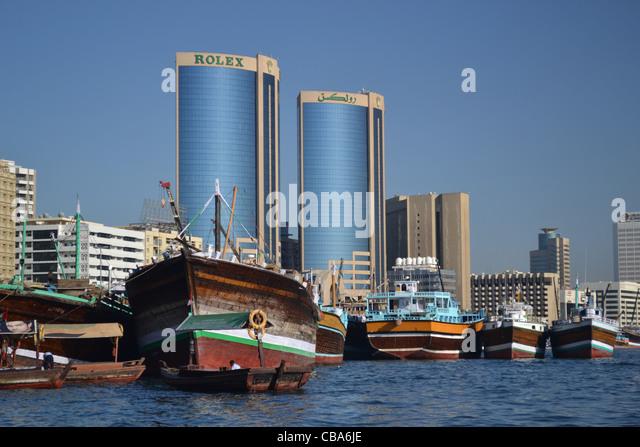 Buildings and boats along the creek, Dubai - Stock Image