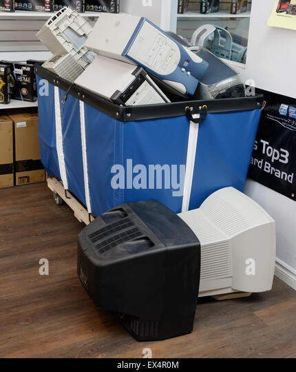 Computers in a recycling bin - Stock Image