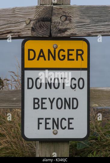 Danger Do Not Go Beyond Fence Sign vertical - Stock Image