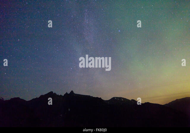 The Milky Way and Aurora Borealis above the peaks Trolltindane and the Troll Wall in the Romsdalen valley, - Stock-Bilder