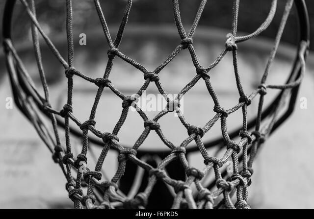 Abstract black and white image of a basketball net - Stock Image