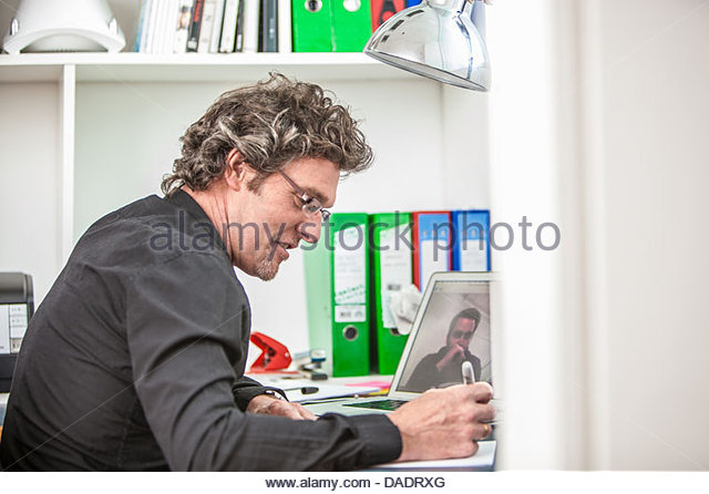Man making video call from office - Stock-Bilder