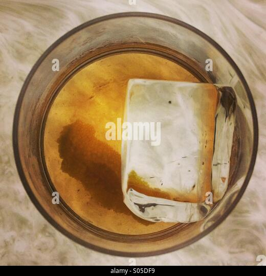 Old Fashioned Cocktail with large ice cube - Stock Image