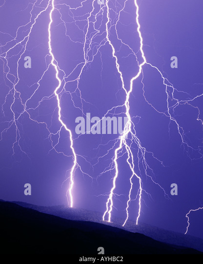 Close striking lightning bolts during summer monsoon storm on the Rincon Mountains in Tucson, Arizona, United States. - Stock Image
