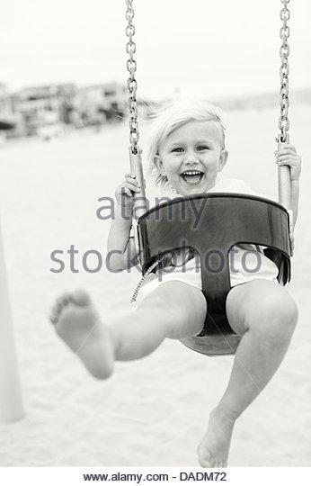 Black & white shot of girl on swing - Stock Image