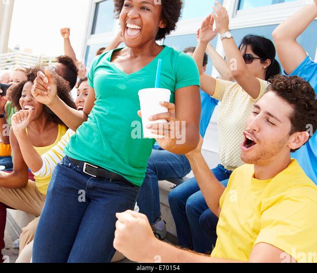 Sports Spectators In Team Colors Celebrating - Stock Image