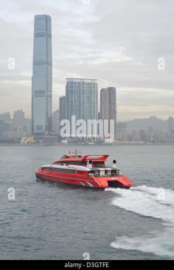 Jetfoil leaving Hong Kong Macau Ferry pier, Hong Kong Harbour, - Stock Image