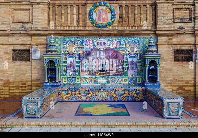 Glazed tiles bench of spanish province of Burgos at Plaza de Espana, Seville, Spain - Stock Image