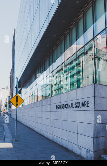 DUBLIN, IRELAND - April 21st, 2018: corporate office buildings in the renovated Docklands area - Stock Image
