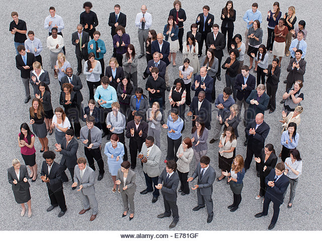 Crowd of clapping business people - Stock Image