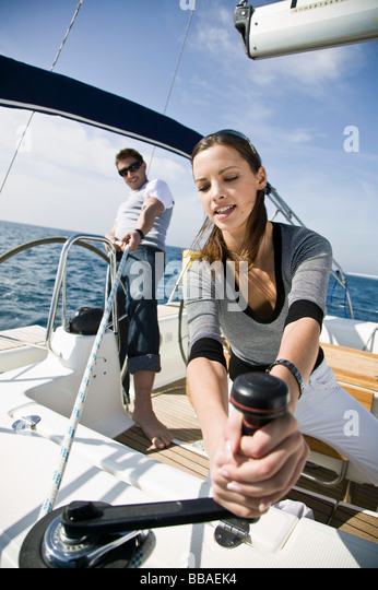 A man and a woman sailing - Stock Image