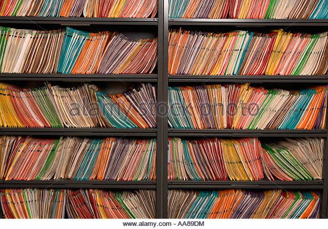 Bookshelves full of folders - Stock Image
