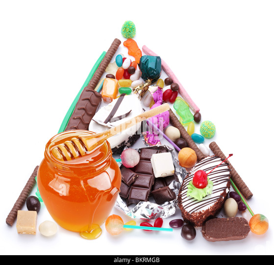 Pyramid in the form of sweets. Isolated on white - Stock Image