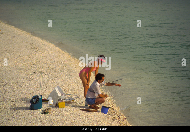woman searches for seashells sanibel captiva islands southwest florida - Stock Image