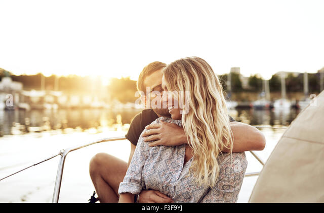 Loving Couple Enjoying Life Sitting outside in on a Summer Evening - Stock Image