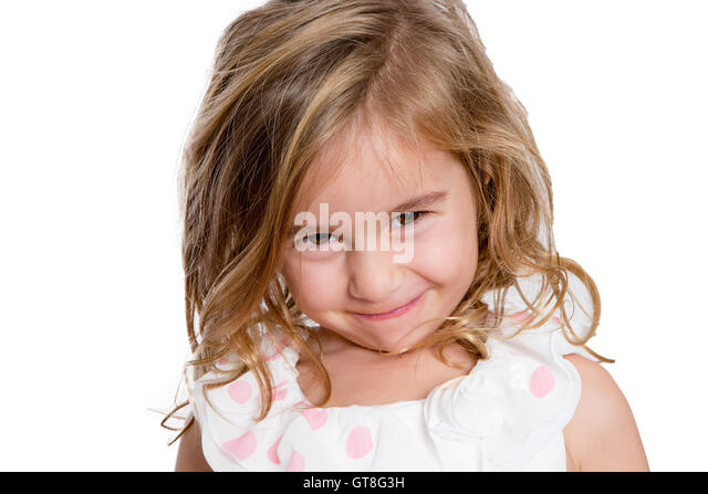 Close up Charming Blond Little Girl Smiling to You Shyly Against White Background. - Stock Image