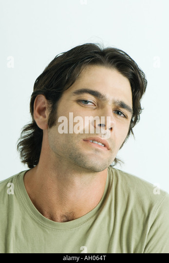Man looking at camera, portrait - Stock Image