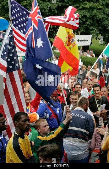 Players and fans parade with their national flags at Homeless World Cup football tournament held in Edinburgh, Scotland - Stock-Bilder