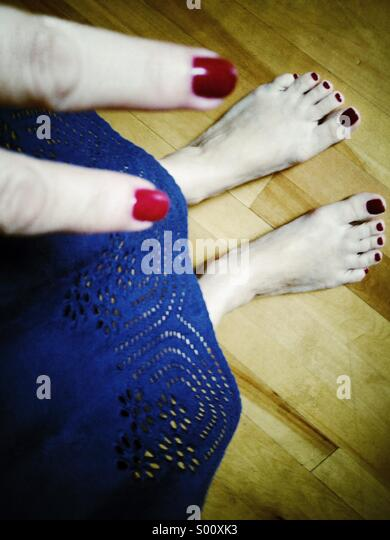 Feet and fingers - Stock Image