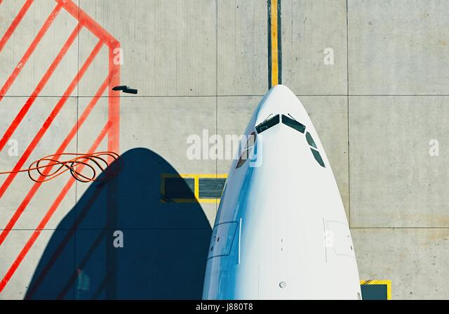 Aerial view of the airport. Airplane taxiing to terminal. - Stock Image