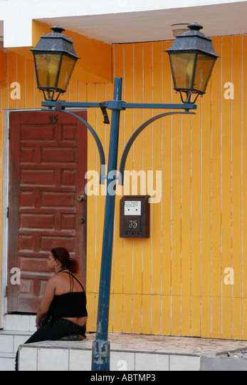 Saint Martin French Marigot Rue Charles de Gualle lamppost Black female - Stock Image