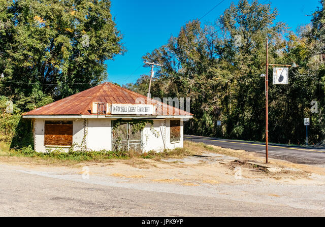 Closed and abandoned Mitchell Creek Grocery building in rural Alabama, reflecting the changing times to a more urban - Stock Image