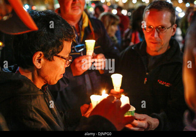 San Francisco, California, USA. 27th Nov, 2013. People light candles preceding a march that was held to mark the - Stock Image