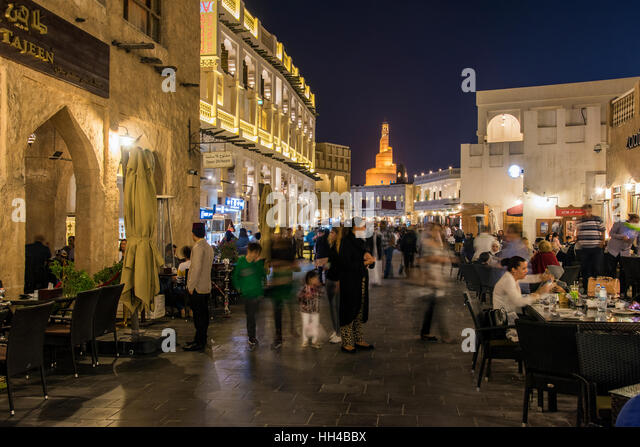 Night view of outdoor cafe restaurant along the pedestrian mall of Souq Waqif area, Doha, Qatar - Stock Image