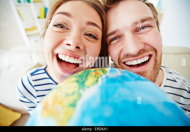 Ecstatic dates looking at camera - Stock Image