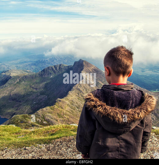 Rear view of boy looking at view - Stock Image