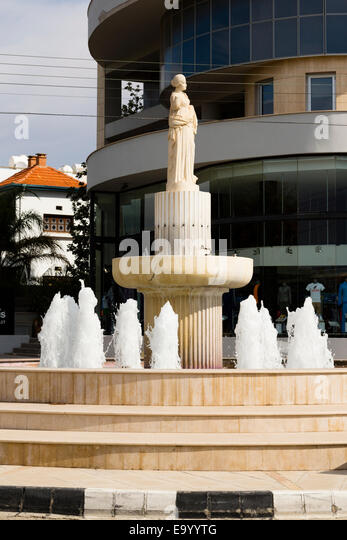 Fountain and statue at Leonides Kiopi roundabout, Larnaca, Cyprus. - Stock Image