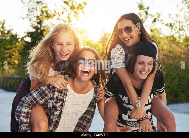 Friends hanging out on a summer day - Stock Image