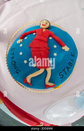 A strong and stable cake decorated with Theresa May - Stock Image