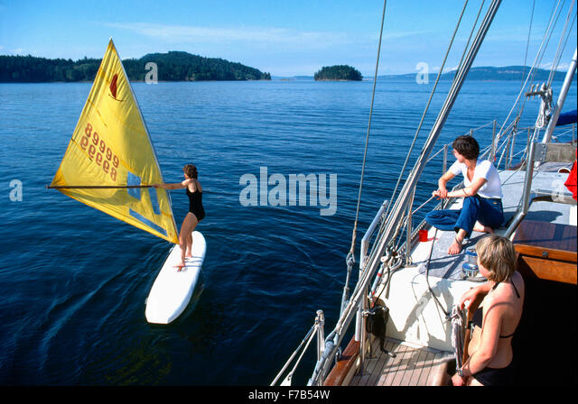 Wind Surfing and Sailing, Gulf Islands, BC, British Columbia, Canada - Woman learning to Wind Surf - Stock Image
