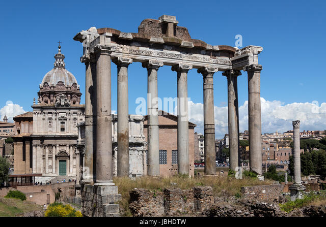 The Temple of Saturn in the Roman Forum in the city of Rome, Italy. Gradual collapse over the centuries has left - Stock Image