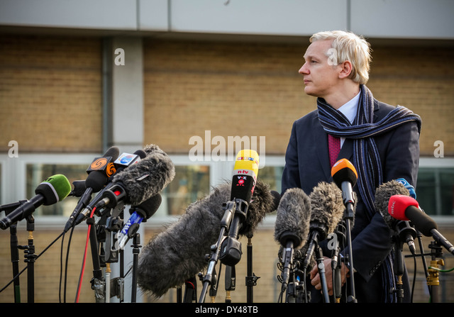Wikileaks founder Julian Assange speaks to the media after appearing at Belmarsh Magistrates court in Woolwich, - Stock Image