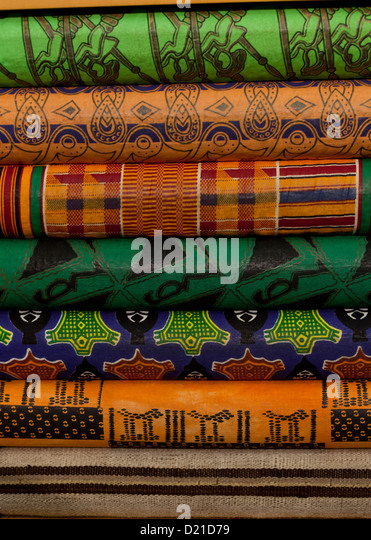 Folded African textile linens - Stock Image