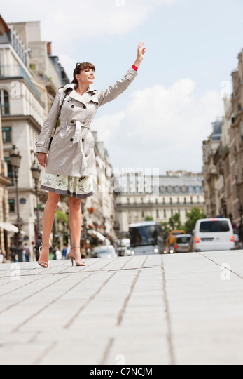 woman by a taxi stock photos woman by a taxi stock images alamy. Black Bedroom Furniture Sets. Home Design Ideas