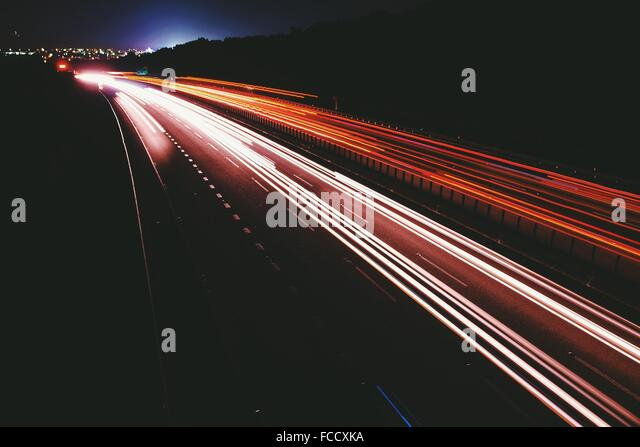 Light Streaks On Road At Night - Stock Image